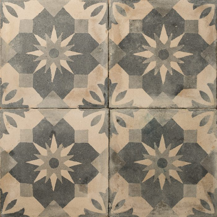 Tile with black and white floral design