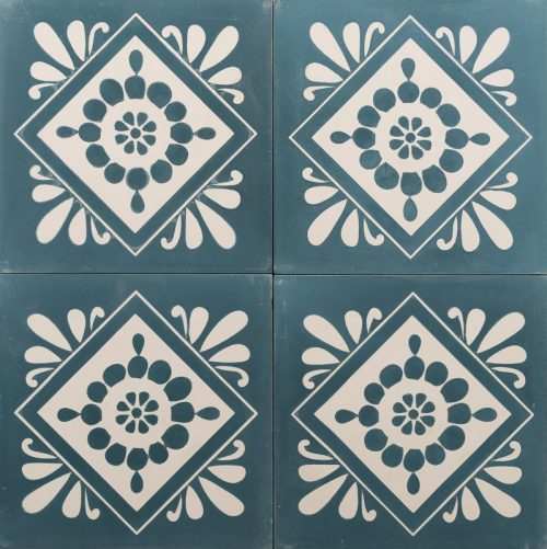 Deep blue tile with a white floral design