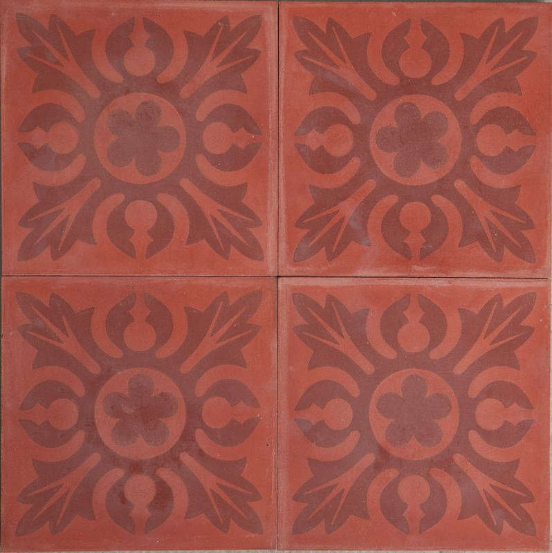 a red tile with a mandala pattern