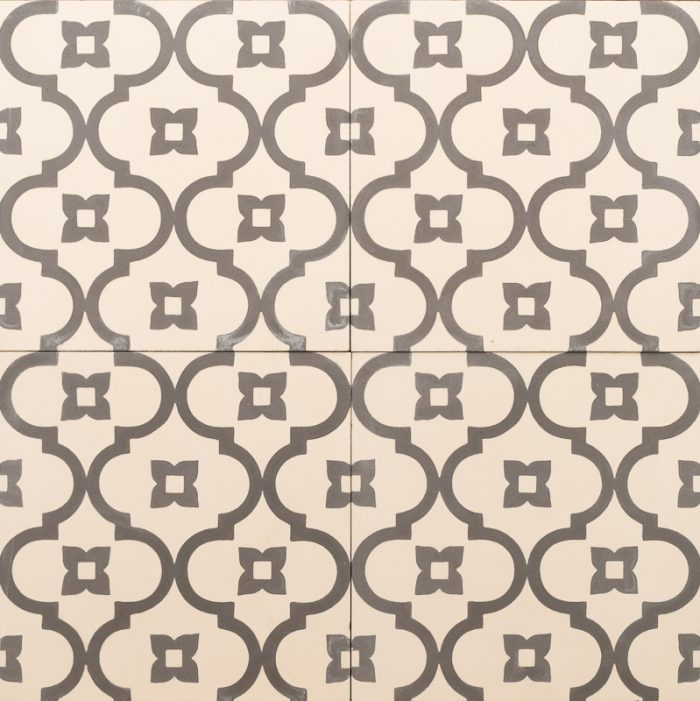 Warm white tile with a charcoal pattern of chains and petite flowers