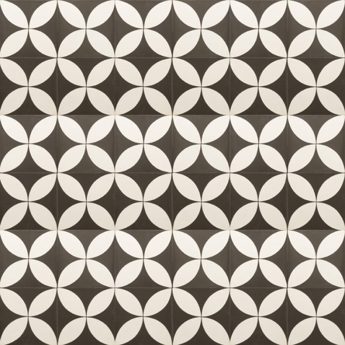black tile with a thick white design that makes up petal shapes