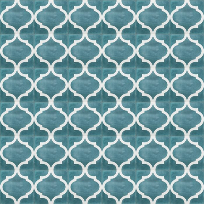Teal tile with white design
